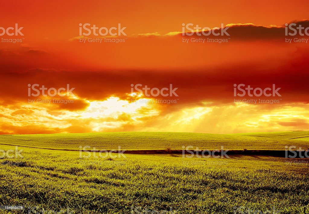 beautiful sunset over green landscape royalty-free stock photo