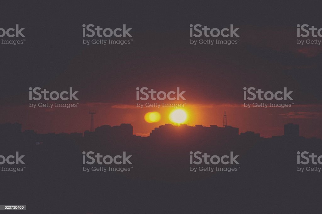 Beautiful sunset over silhouette city skyline stock photo