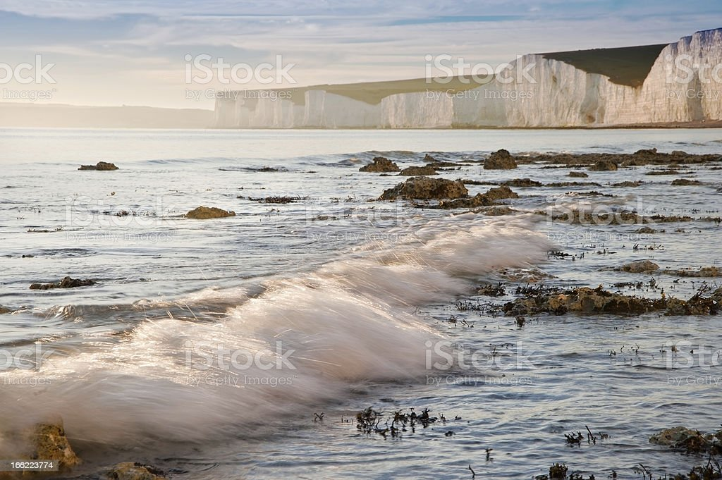 Beautiful sunset over Summer ocean with cliffs stock photo