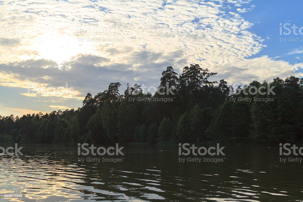 Beautiful sunset over surface of the lake. Foggy. stock photo