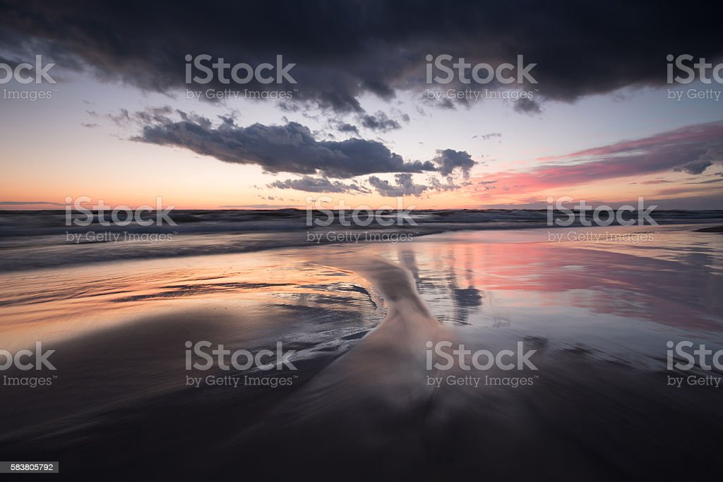 Beautiful sunset over the beach at bredsand in sweden stock photo