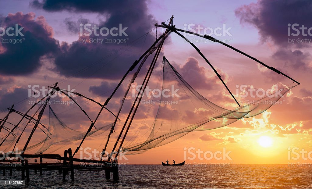 Beautiful sunset over the Chinese fishing nets in Cochin  stock photo