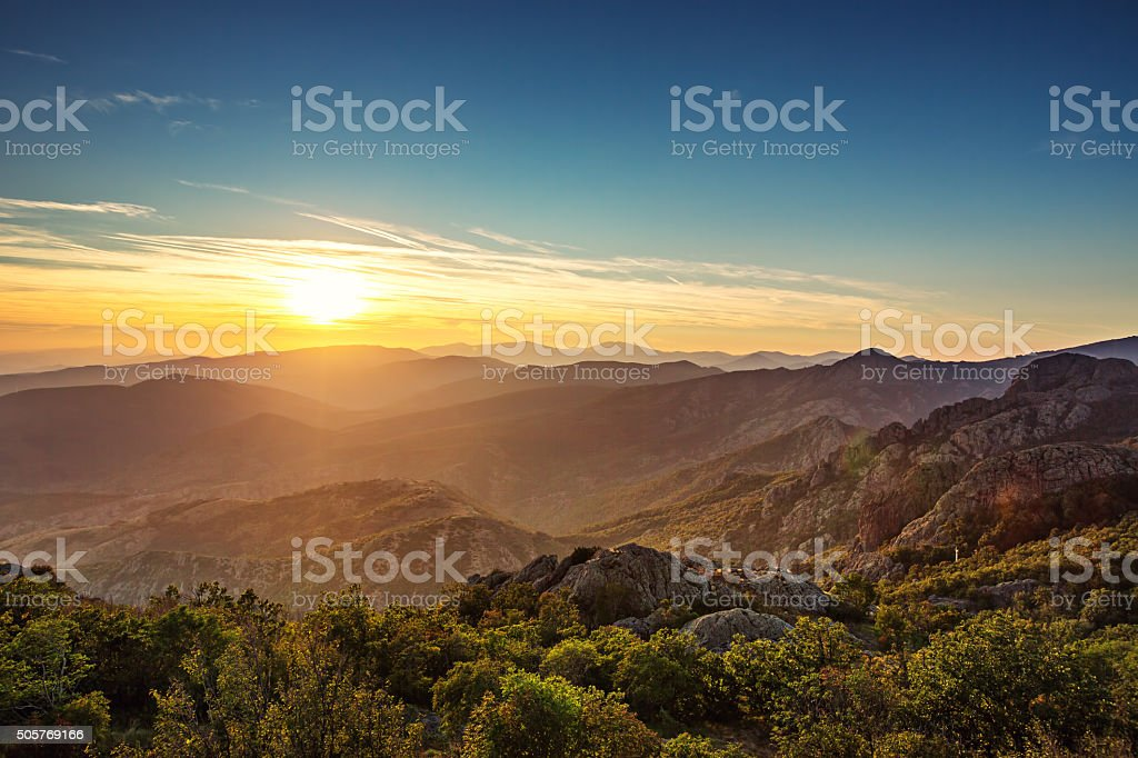 Beautiful sunset over the mountain stock photo