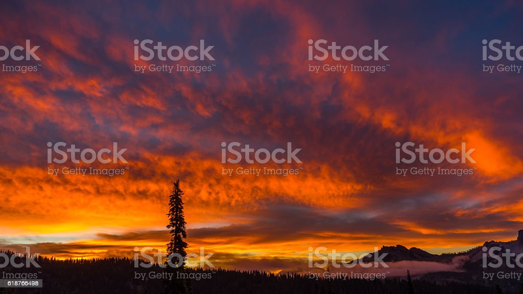 Beautiful sunset over the mountains. Bright colors stock photo