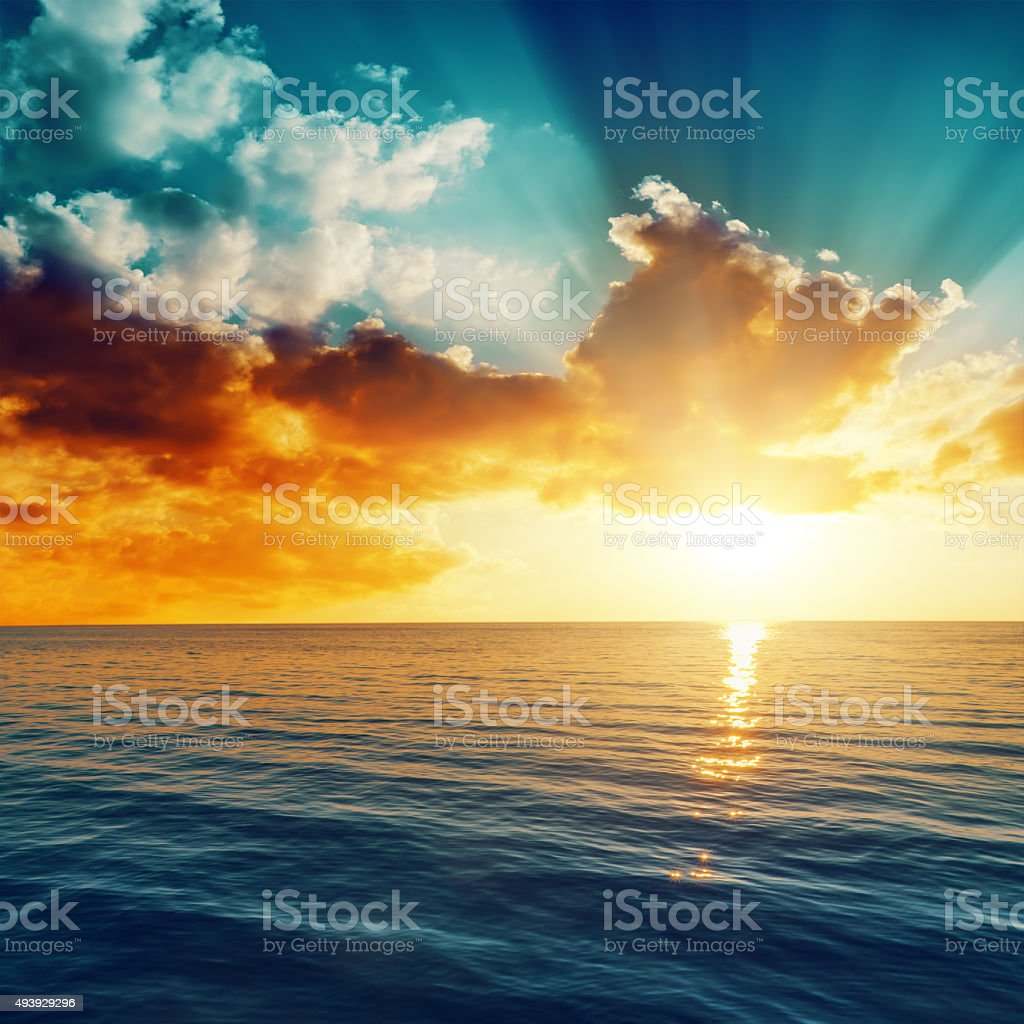 beautiful sunset over the sea stock photo