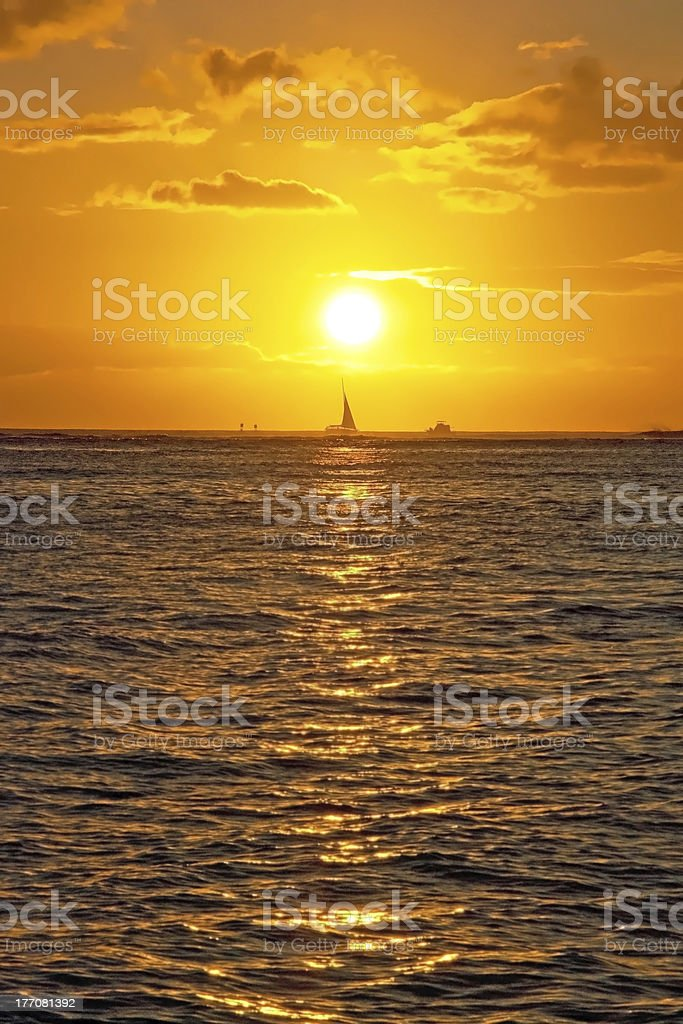 Beautiful sunset with boat on ocean Hawaii royalty-free stock photo