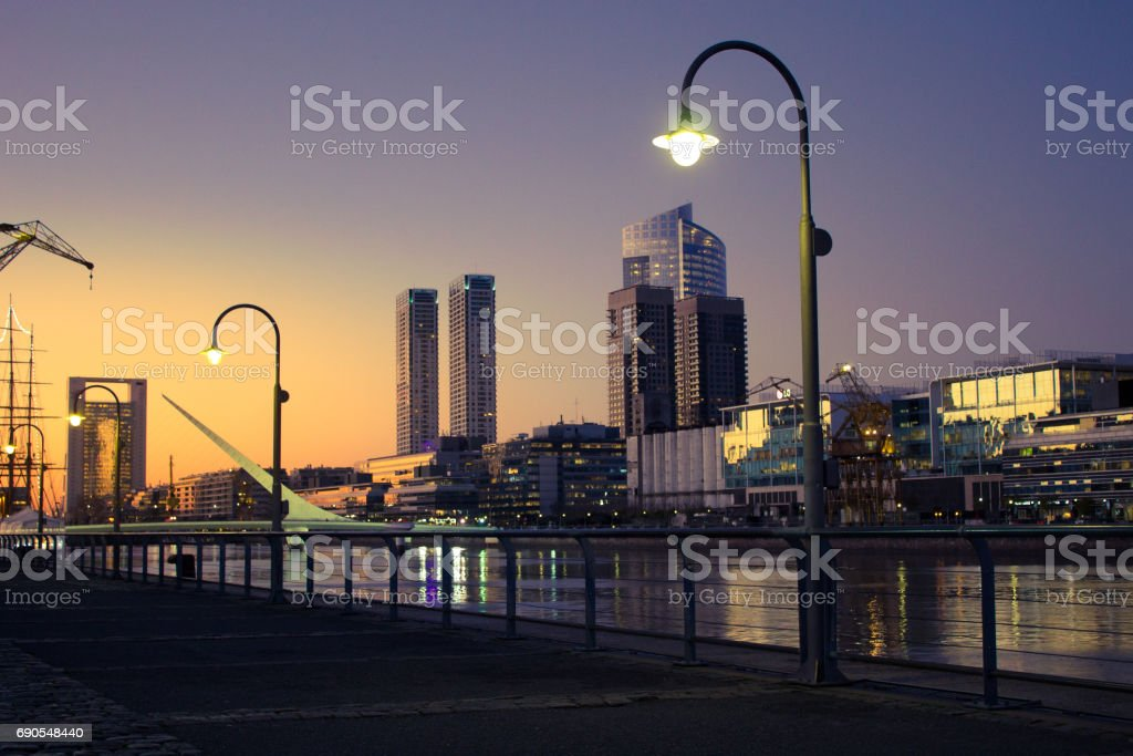 Beautiful sunset with buildings in background, Puerto Madero, Buenos Aires, Argentina. stock photo
