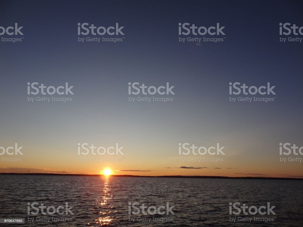 Beautiful sunset with dark sky and Vättern lake in Sweden stock photo