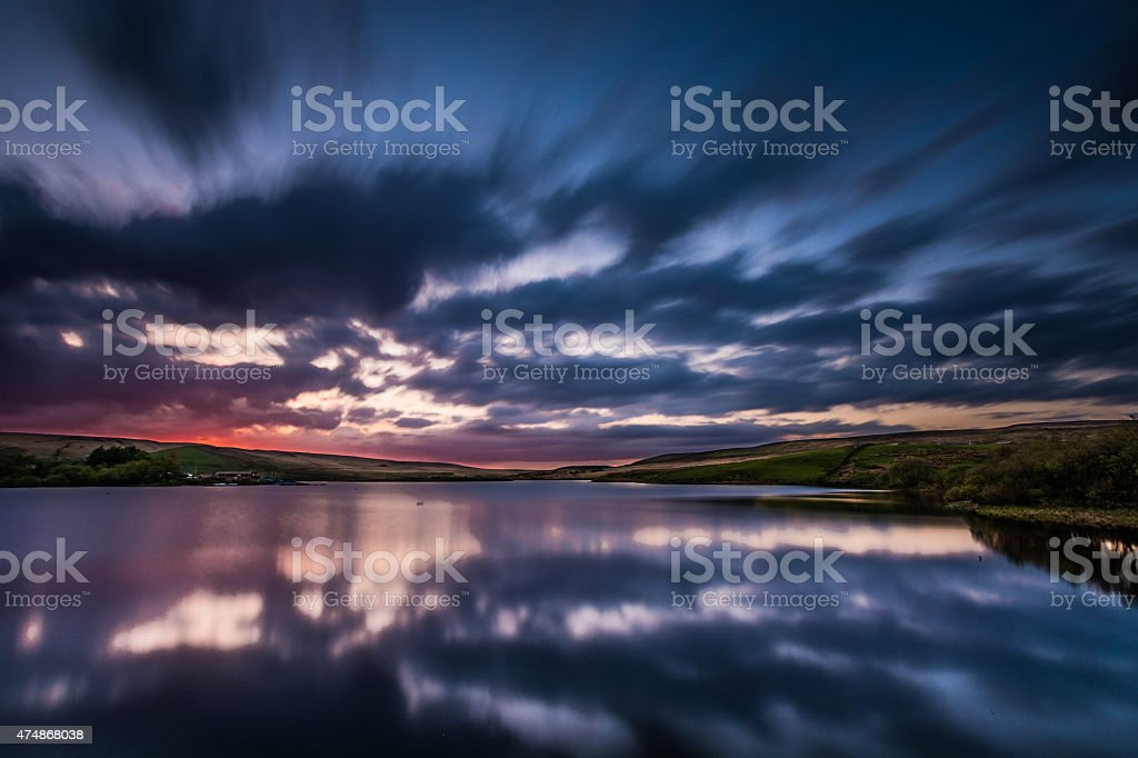 Beautiful Sunset With Dramatic Moving Clouds. stock photo