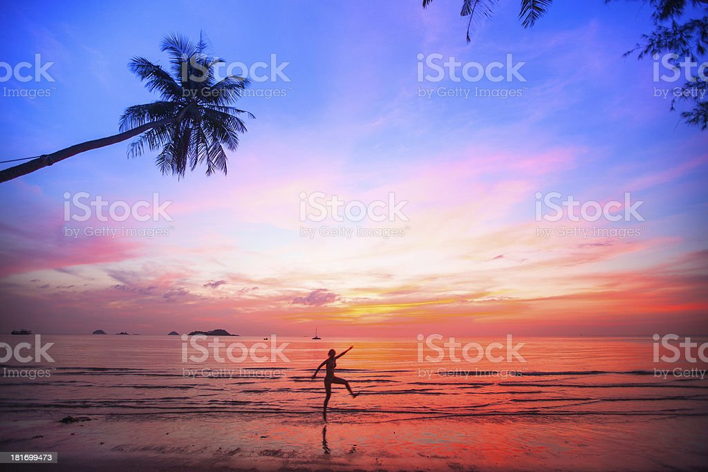Beautiful sunset with silhouettes of girls on a beach royalty-free stock photo