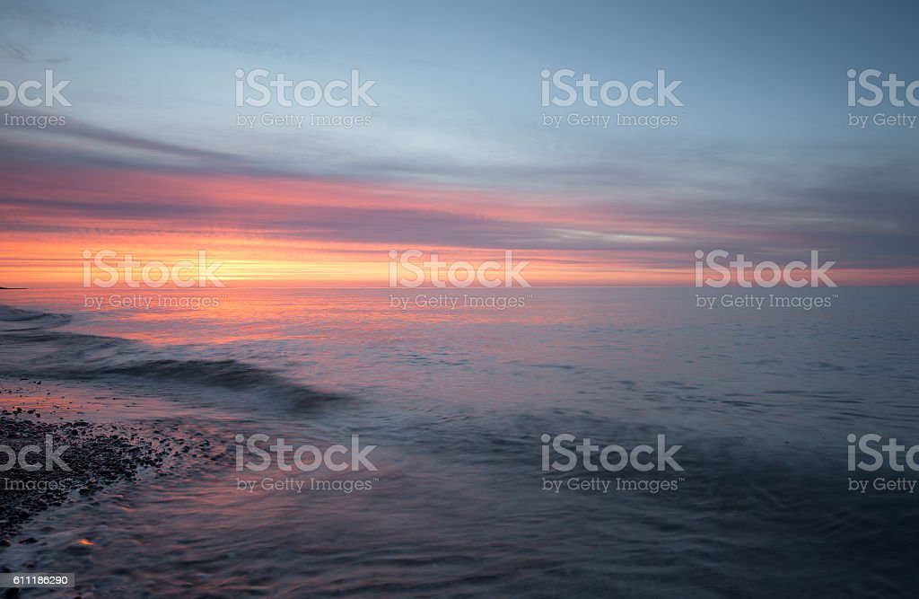 Beautiful sunsetting after a summers day at the beach stock photo