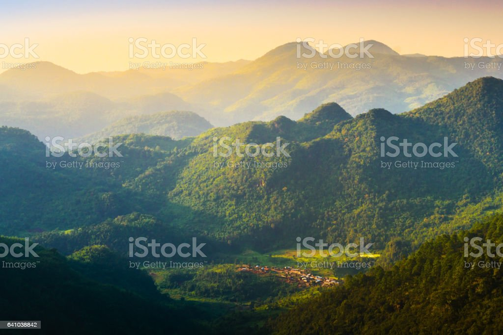 Beautiful sunshine at misty morning mountains at north thailand stock photo