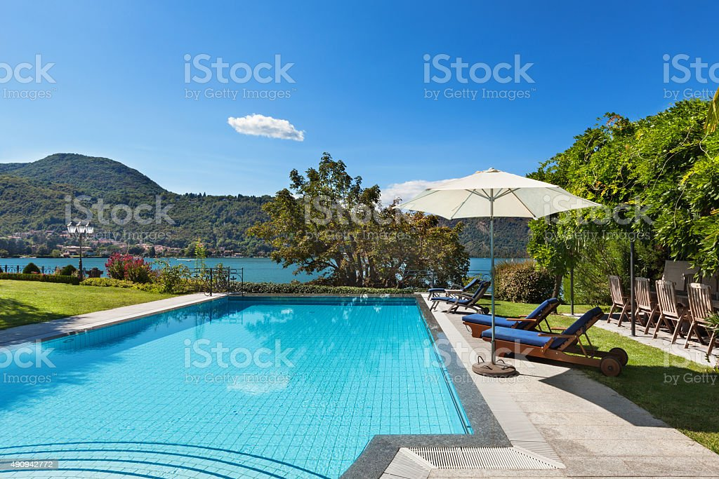 beautiful swimming pool overlooking the lake stock photo