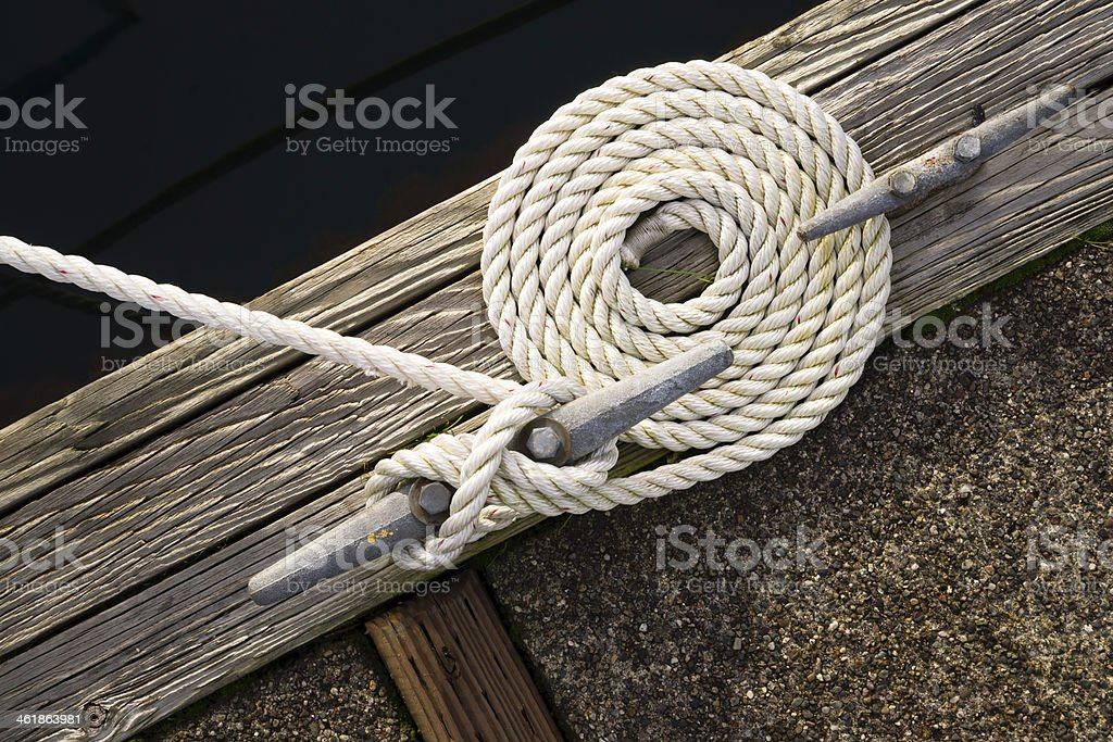 Beautiful Swirled Curled Rope Boat Bow Line Nautical Tie Down stock photo