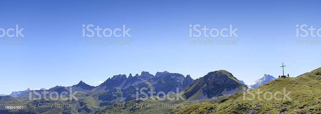 Beautiful Swiss Mountains Panorama Range with Christian Cross stock photo