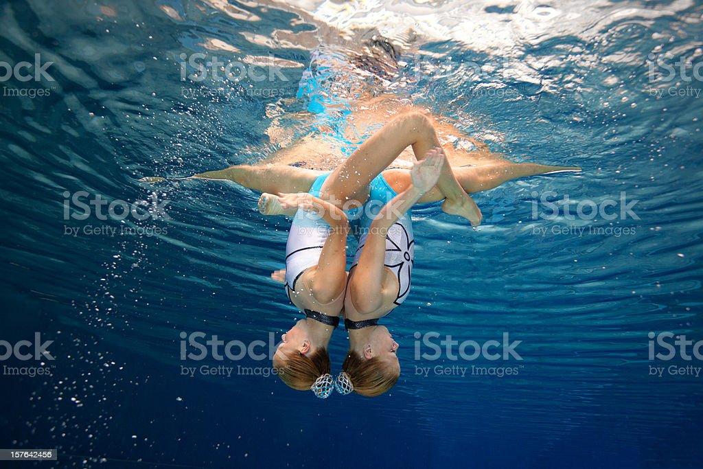 beautiful synchronized swimming unity stock photo
