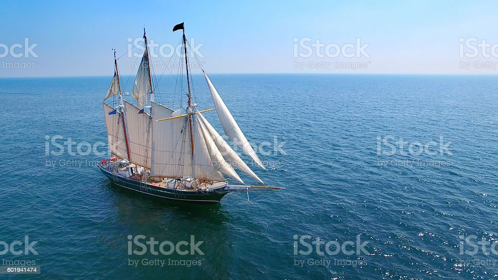 Beautiful tall ship sailing calm waters in good weather stock photo