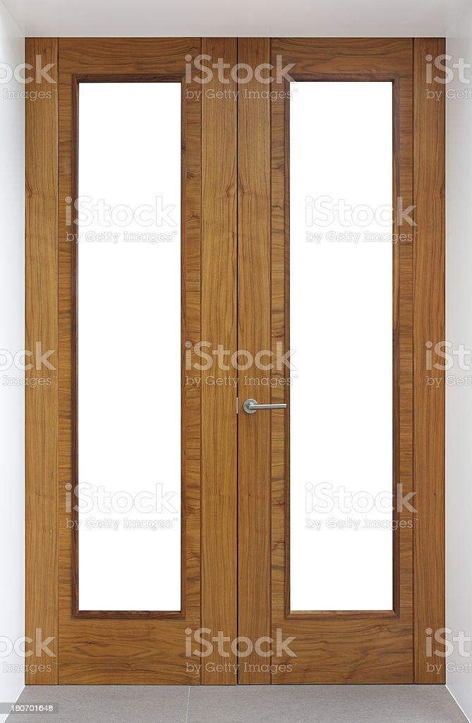 Beautiful tall walnut wood internal doors stock photo