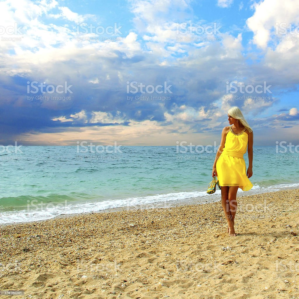 Beautiful tanned blonde girl on the sea royalty-free stock photo