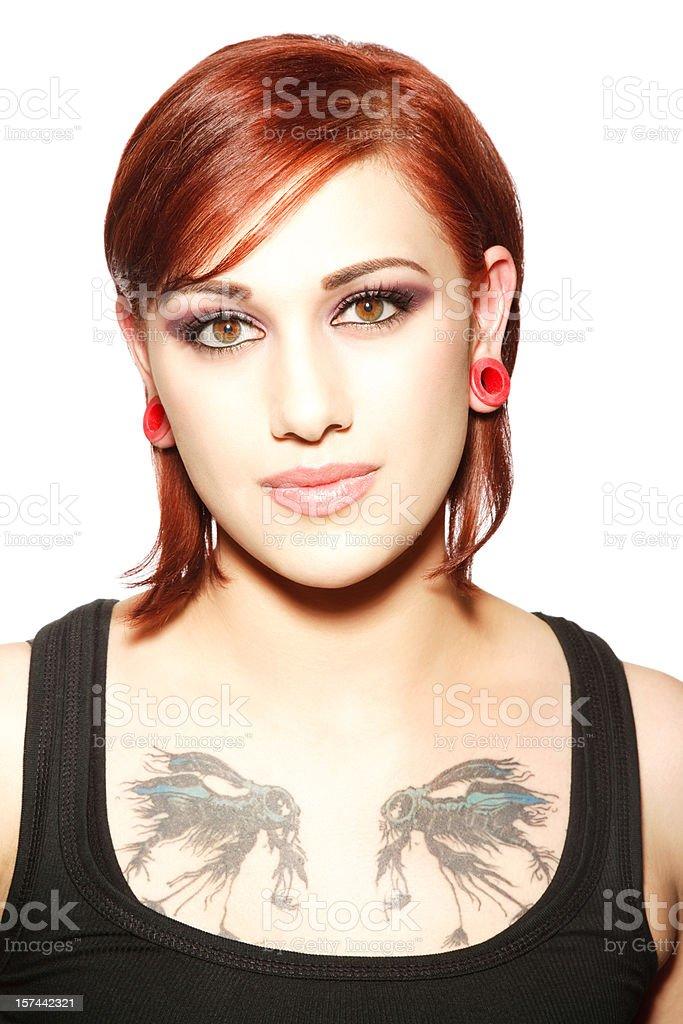 Beautiful Tattooed Redheaded Woman royalty-free stock photo