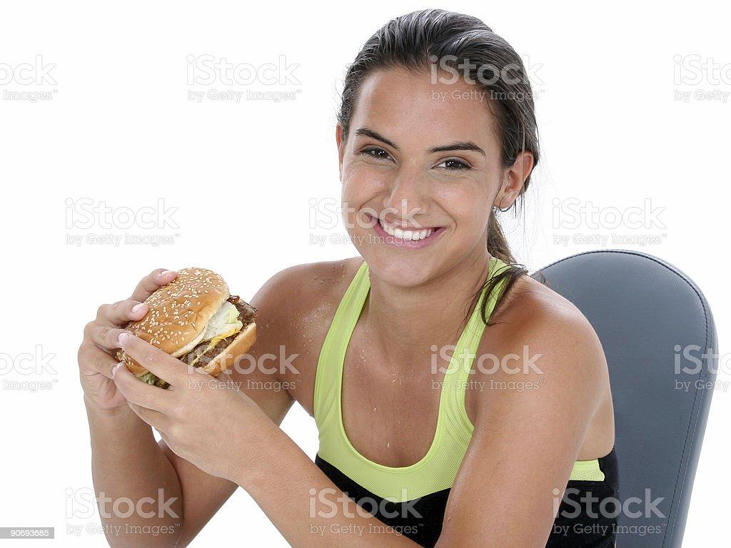 Beautiful Teen Girl Holding A Giant Cheeseburger royalty-free stock photo