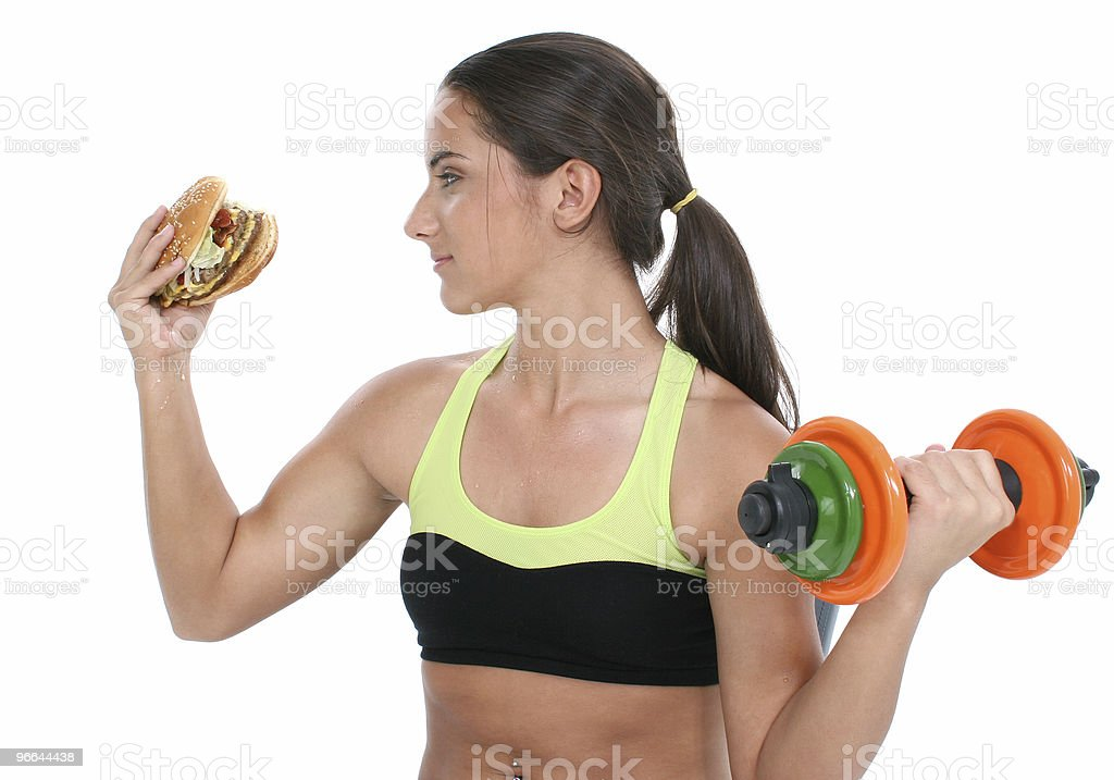Beautiful Teen Girl Holding Colorful Weights And A Giant Cheeseb royalty-free stock photo