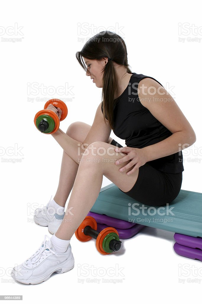 Beautiful Teen Girl Holding Colorful Weights Over White stock photo