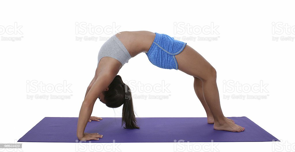 Beautiful Teen Girl In Workout Clothes Doing Backbend stock photo