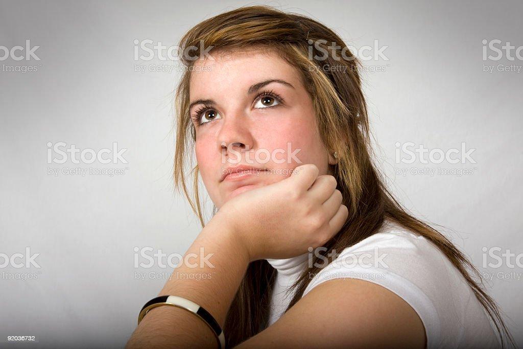 Beautiful teen girl looking up (DEPRESSION SERIES) stock photo