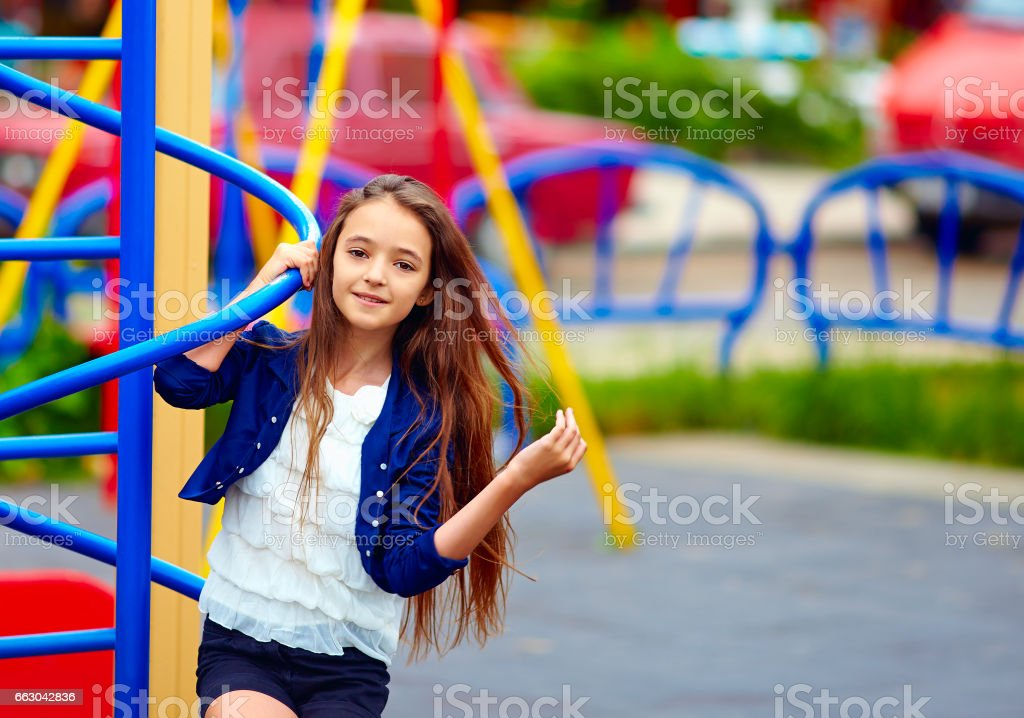 beautiful teen girl on playground stock photo