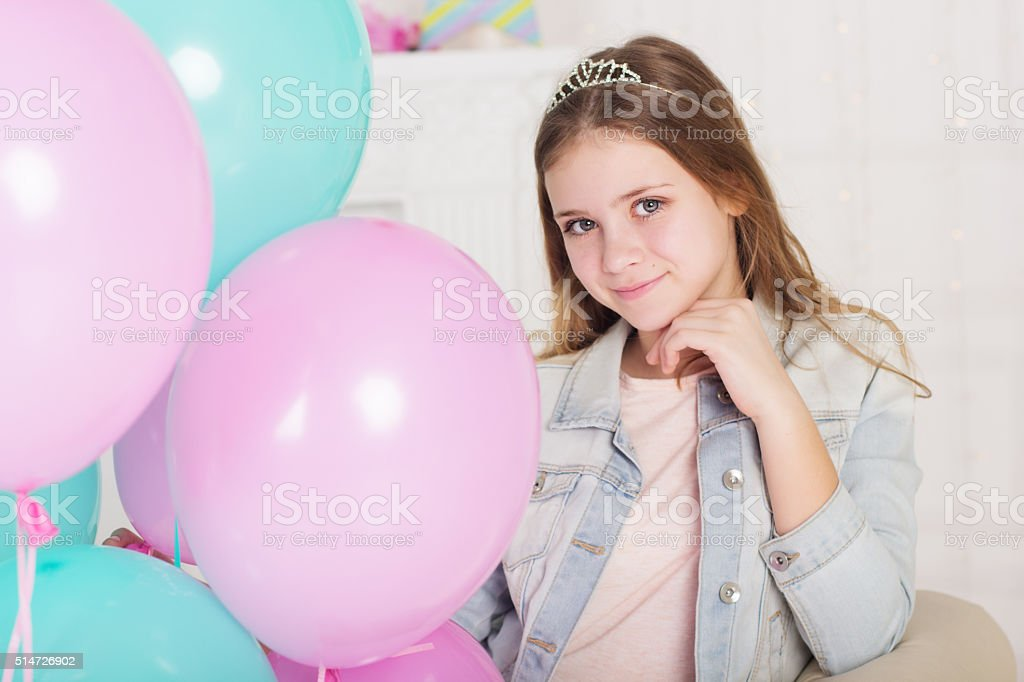 Beautiful teen girl with blue and pink balloons stock photo