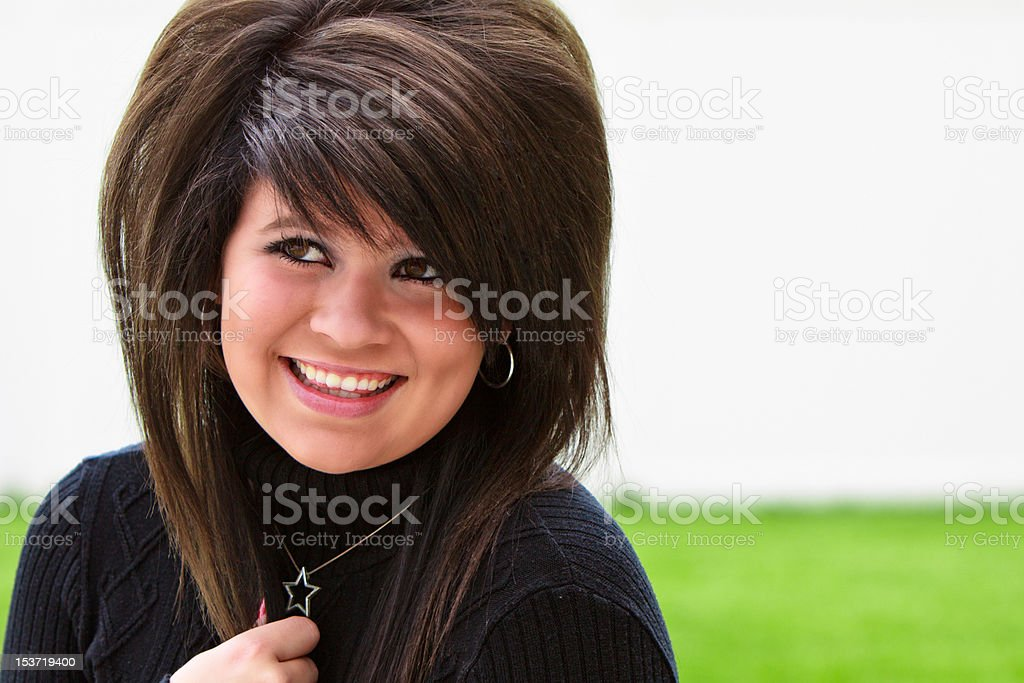 Beautiful teen smiling in a black sweater royalty-free stock photo