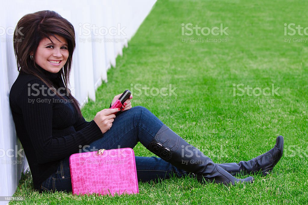 Beautiful teen talking on the phone royalty-free stock photo