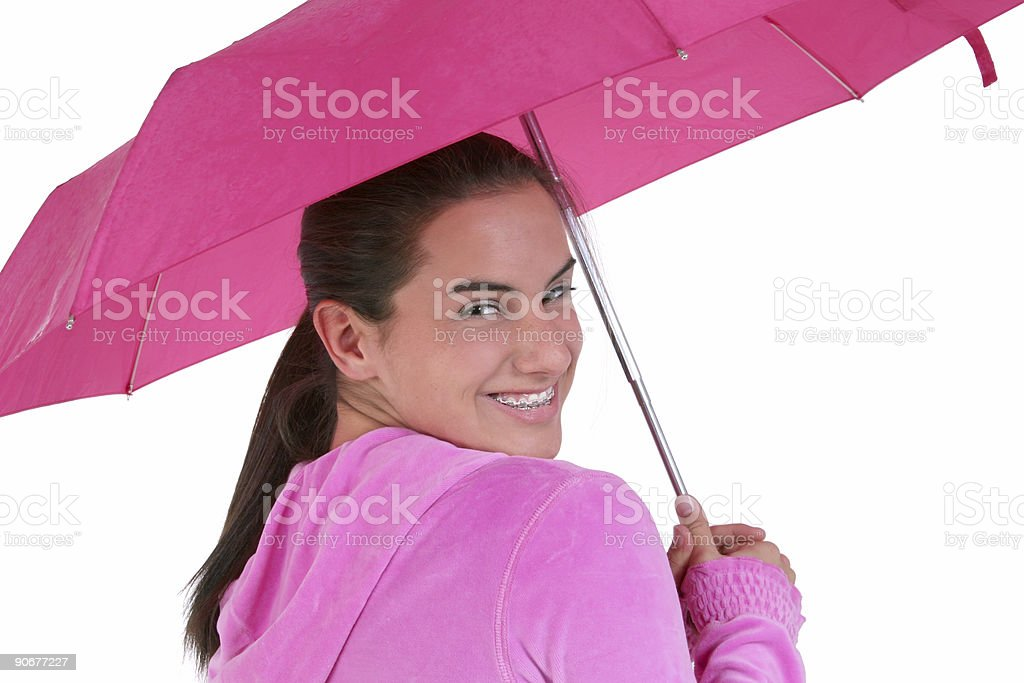 Beautiful Teen With Braces Under A Pink Umbrella royalty-free stock photo