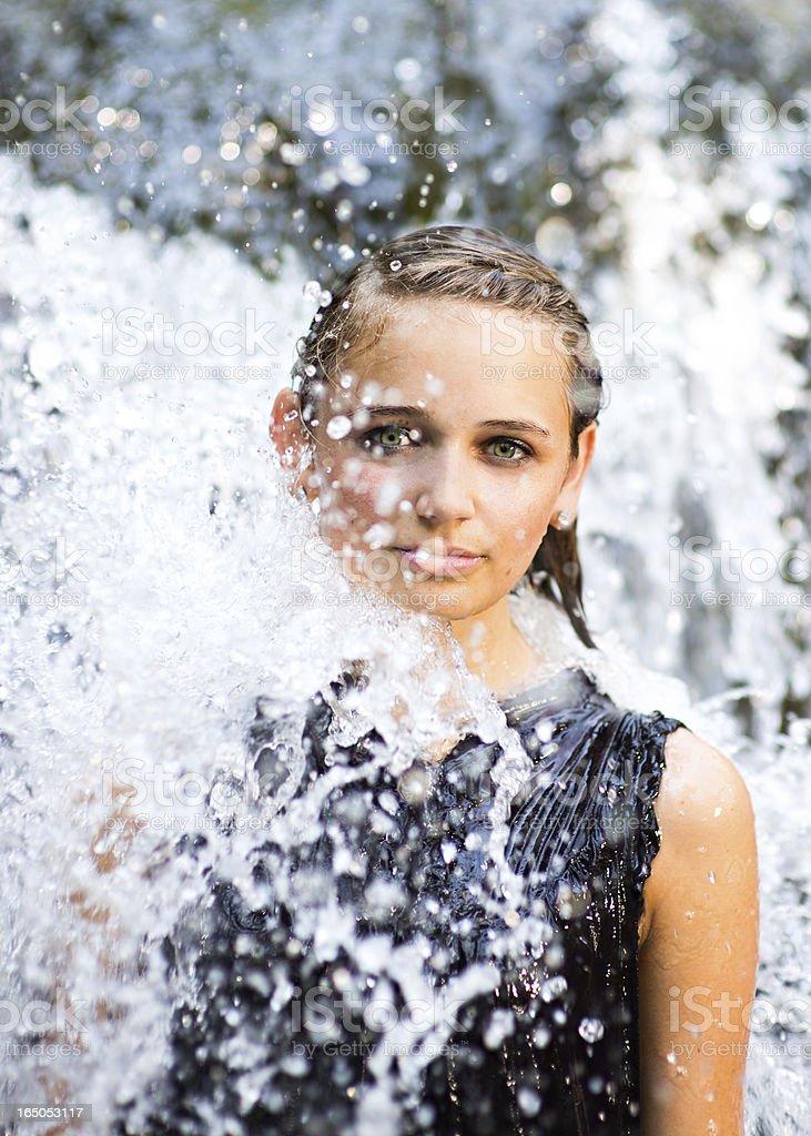 Beautiful Teen Woman Enjoying Waterfall stock photo