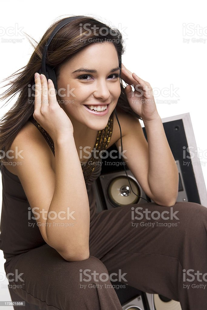Beautiful Teenage Brunette Girl Smiling Listening to Music with Headphones royalty-free stock photo