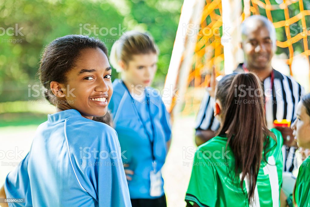 Beautiful teenage female soccer player before game stock photo