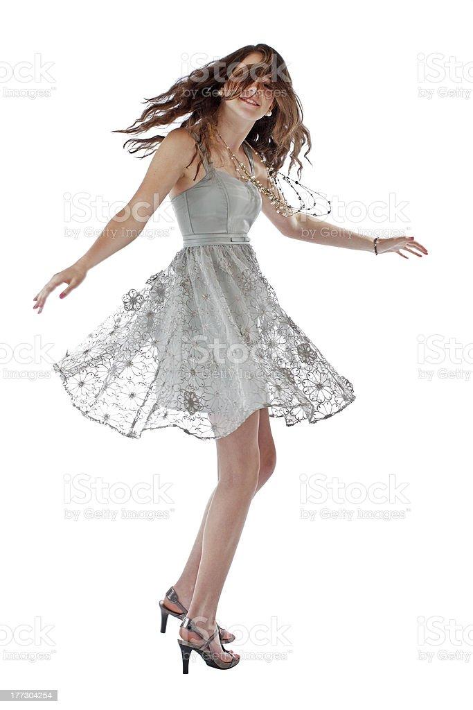 Beautiful teenage girl twirls in lace party dress royalty-free stock photo