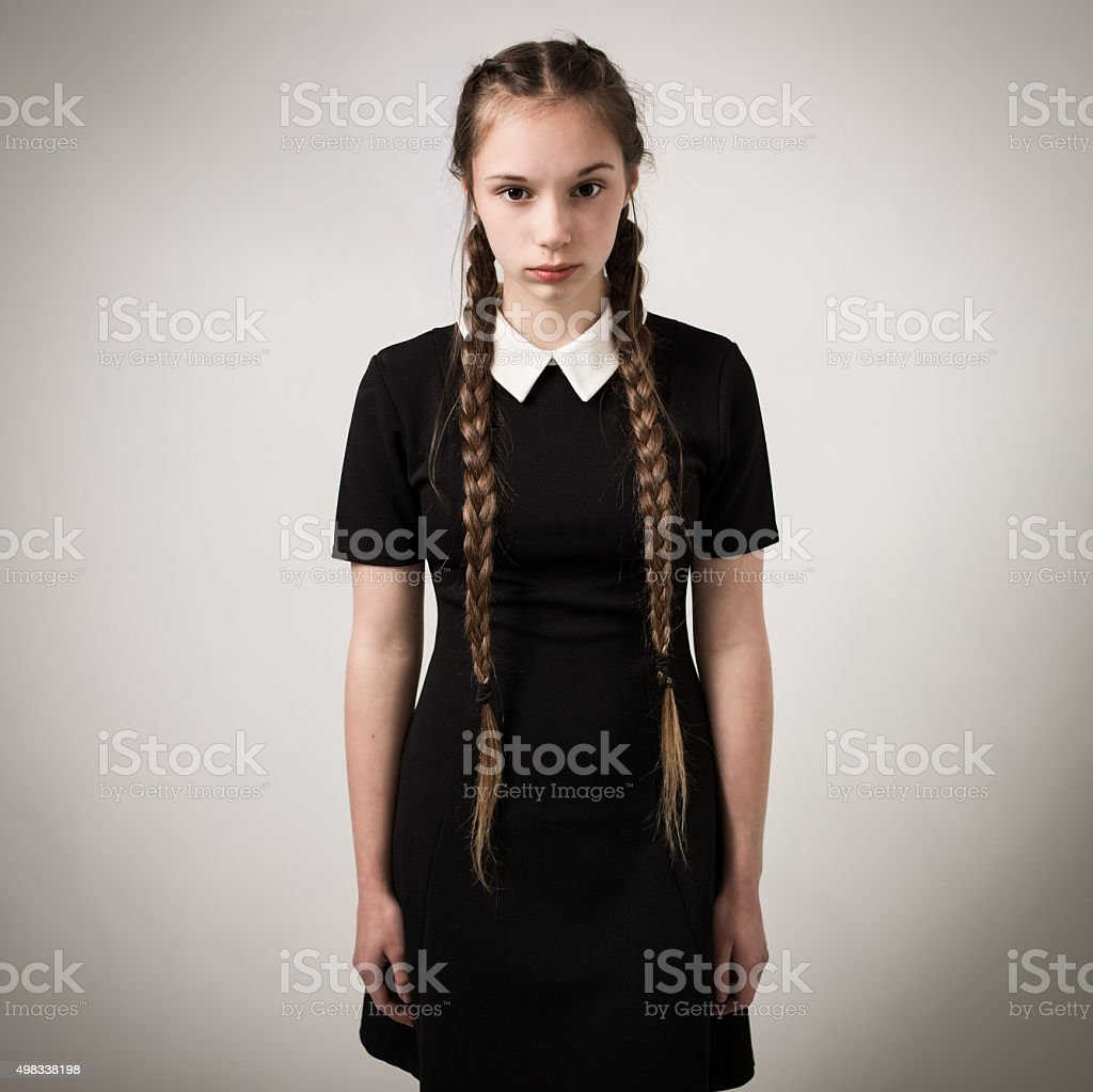 Beautiful Teenage Girl With Plaits Dressed In Black stock photo