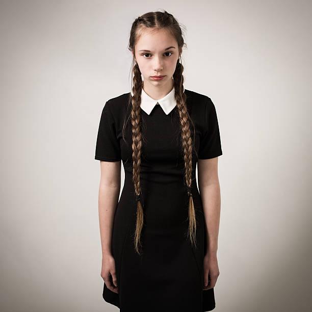 Beautiful Teenage Girl With Plaits Dressed In Black bildbanksfoto