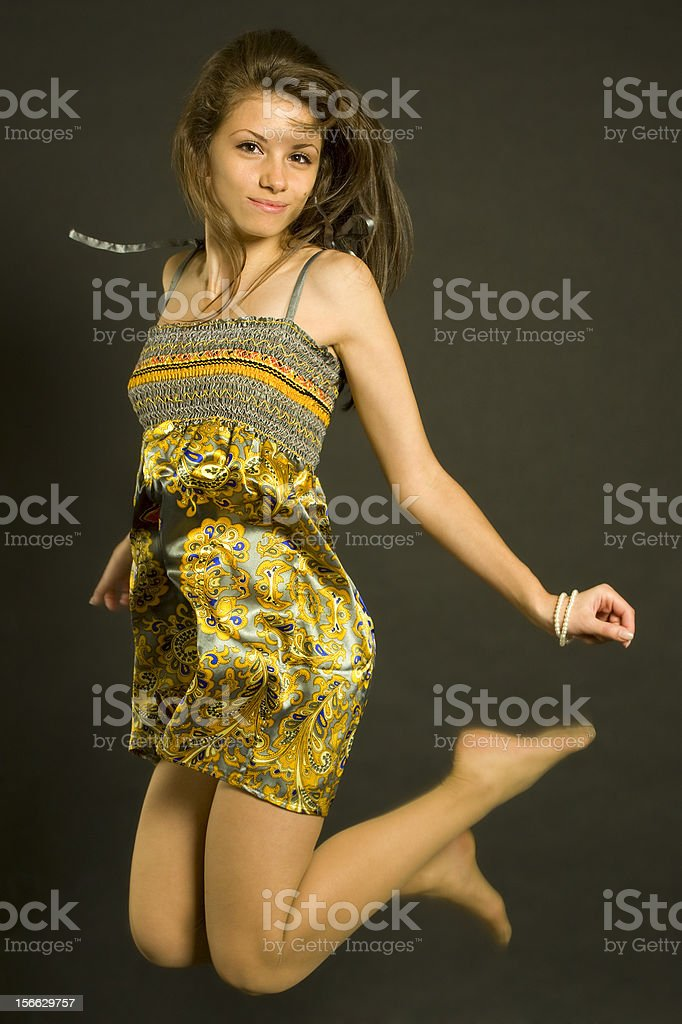 Beautiful teenager girl jumping royalty-free stock photo