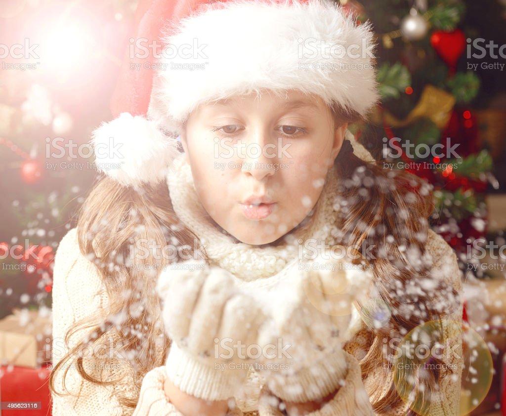 beautiful teenager girl on the background of Christmas tree stock photo