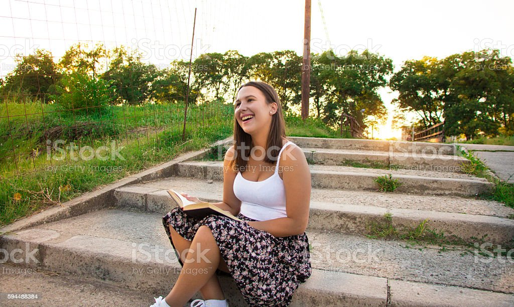 beautiful teenager reading a book and relax stock photo