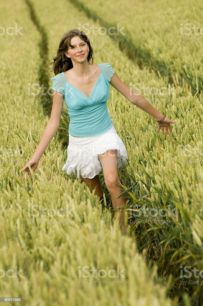 Beautiful teenager running in cereal royalty-free stock photo