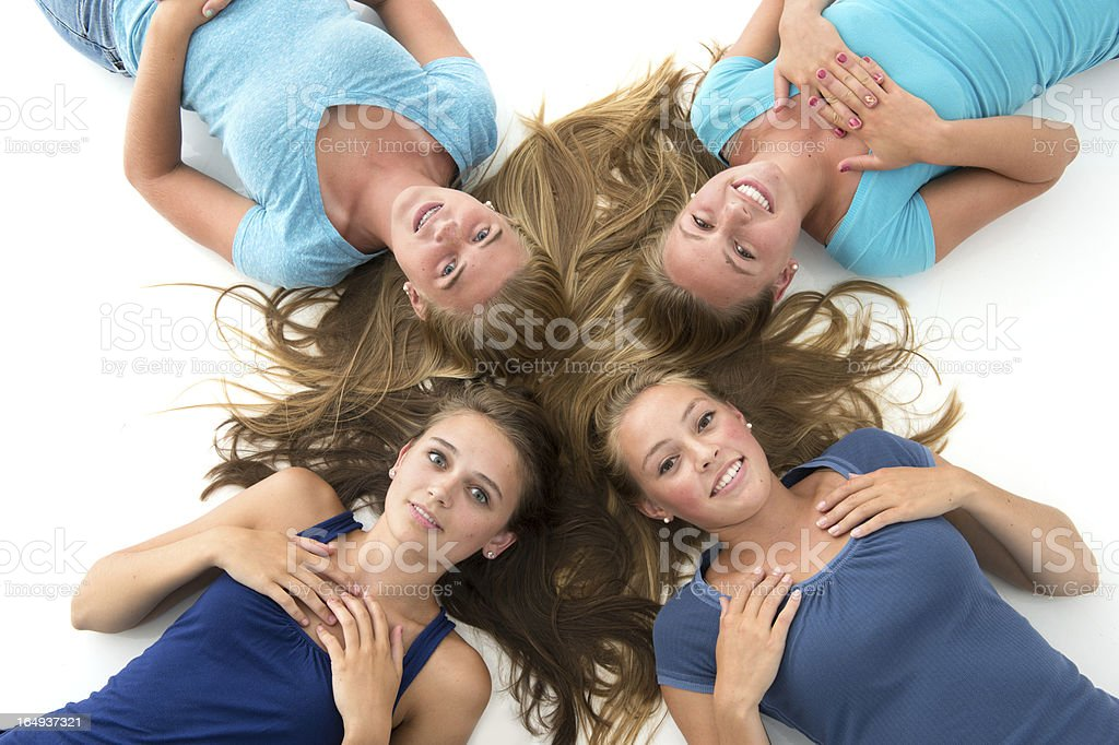 Beautiful teens put their heads together stock photo