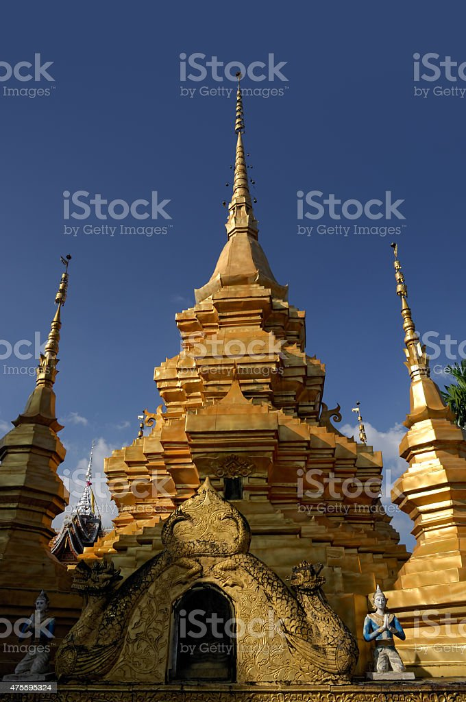 Beautiful temple with golden chedi stock photo