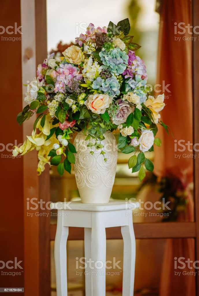 Beautiful tender bouquet on elegant white stand (table) stock photo