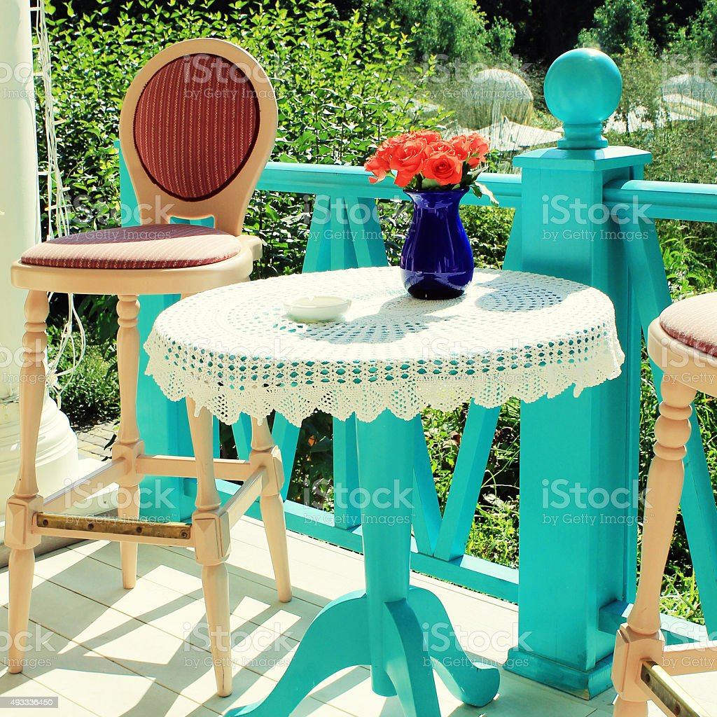 Beautiful terrace with bright colored furniture in country restaurant stock photo