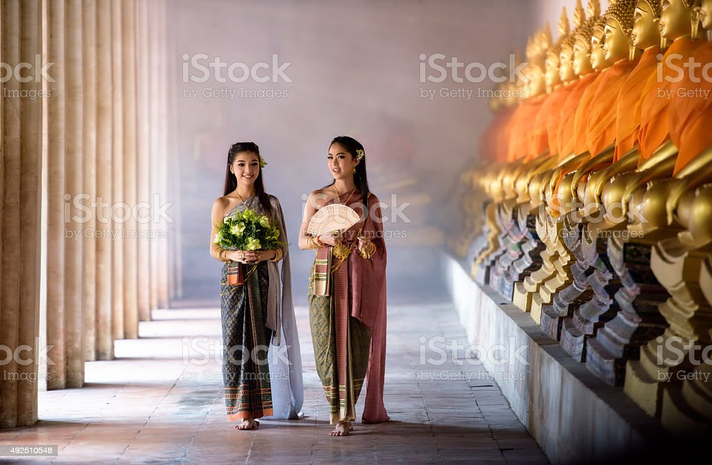 Beautiful Thai girl in Thai traditional costume stock photo