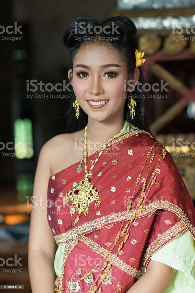 Beautiful Thai Girl in Traditional Dress Costume stock photo